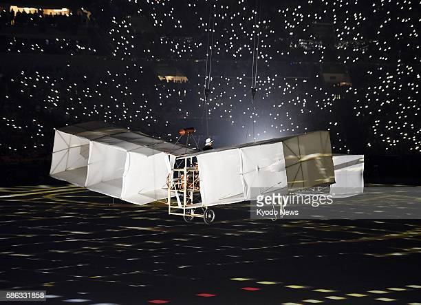 An airplane appears at the Maracana stadium during the lively opening ceremony of the Rio de Janeiro Olympic Games on Aug. 5, 2016.