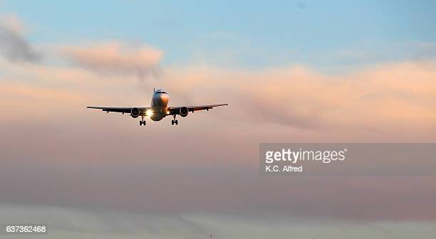 an airplane approaches an airport in san diego, california. - landing gear stock photos and pictures