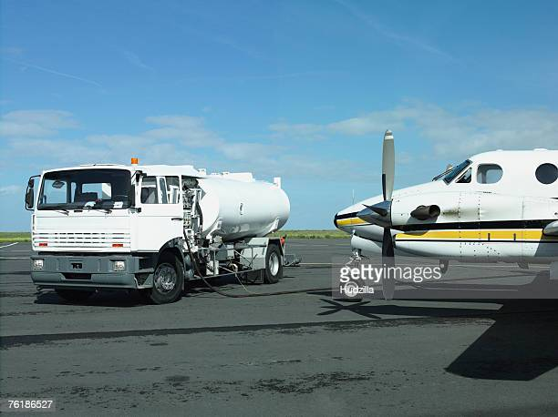 An airplane being refueled on a runway