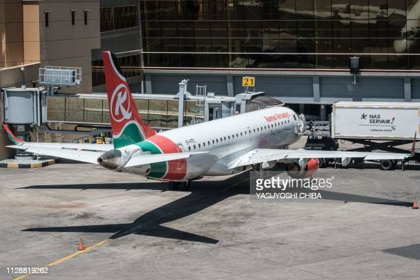 An airplane belonging to Kenya Airways stands stationed at a departure terminal during a strike by airline workers at the Jomo Kenyatta International...