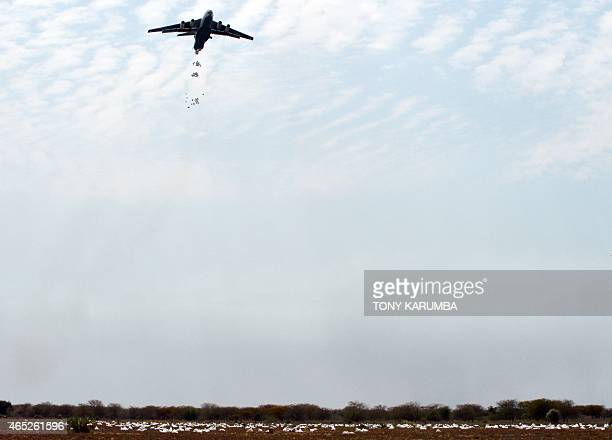 An airplane carries out an food-drop over a field at a village in Nyal, an administrative hub of Panyijar county in Unity state, south Sudan, spilt...