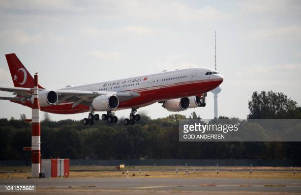 An airplane carrying onboard the Turkish President lands at Berlin's Tegel airport on September 27 2018 Turkish President Recep Tayyip Erdogan is in...