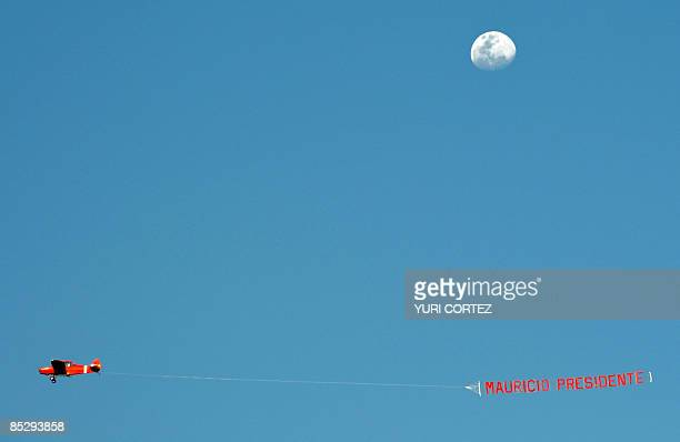 An airplane drags a banner supporting the presidential candidate of the Farabundo Marti National Liberation Front Mauricio Funes during the closing...