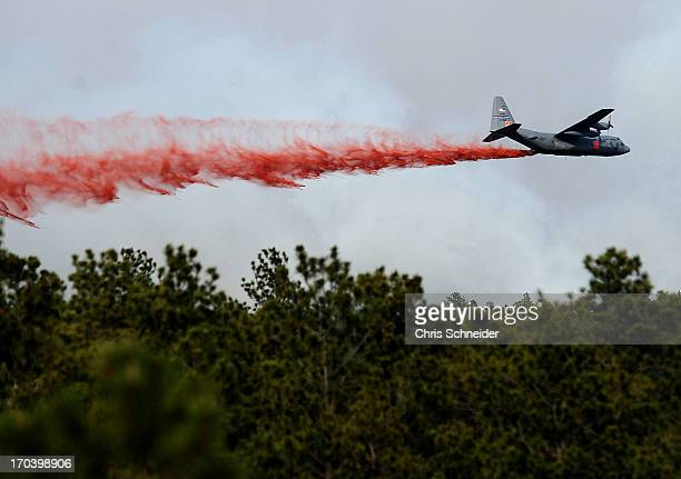 An airplane drops flame retardant over the Black Forest Fire on June 12 2013 north of Colorado Springs Colorado The fire has reportedly burned 80 to...