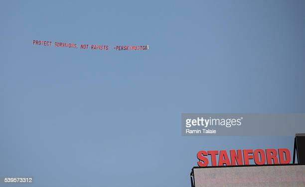 An airplane flies a banner in protest above the Stanford University Stadium during the 125th Stanford University commencement ceremony on June 12...