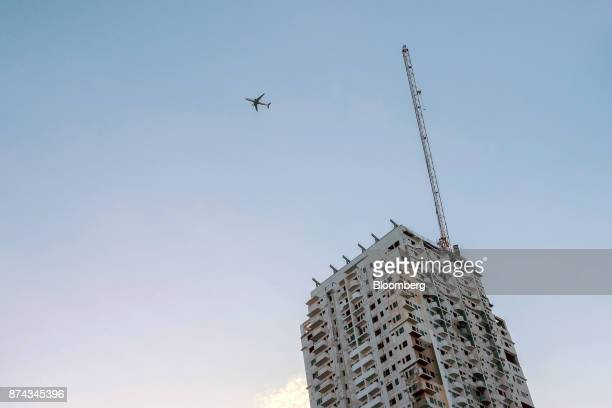 An airplane flies over a residential development in Quezon City Metro Manila Philippines on Tuesday Nov 14 2017 Economists are forecasting the...