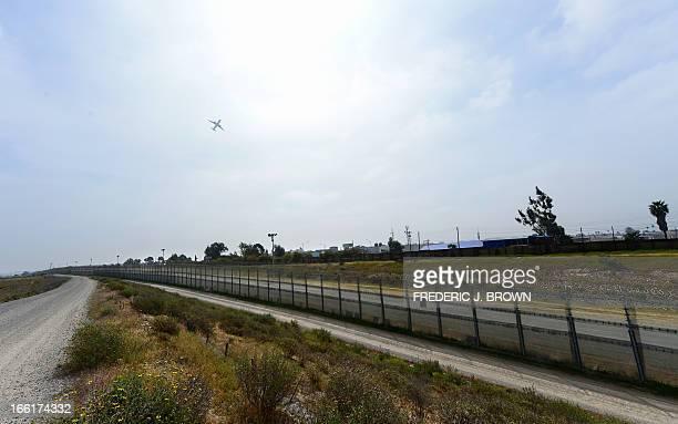 MACOR EEUUMIGRACIÓNSEGURIDADHISPANOS An airplane flies over the USMexico border between the Otay Mesa and San Ysidro port of entries in and near San...