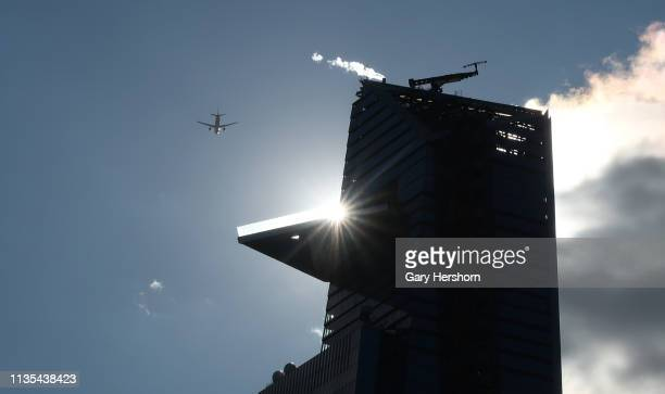 An airplane flies past the outdoor observation deck at 30 Hudson Yards called New York Edge on March 12 2019 in New York City