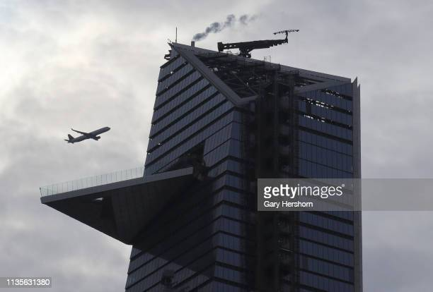 An airplane flies past the outdoor observation deck at 30 Hudson Yards called New York Edge on March 13 2019 in New York City