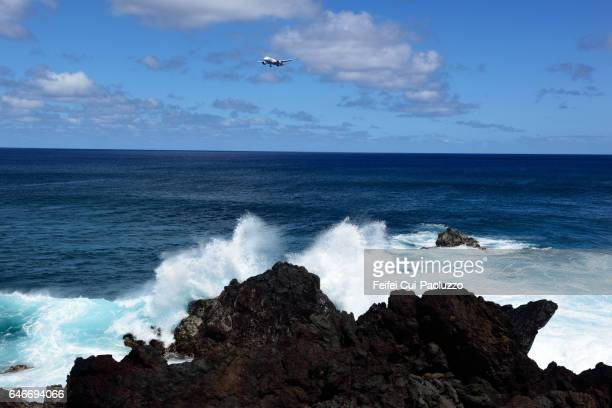 An airplane flying through Pacific Ocean of Easter Island of Chile
