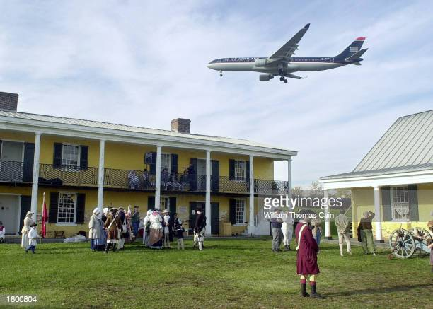 An airplane flys over Fort Mifflin during the reenactment of the siege of Fort Mifflin November 9 2002 in Philadelphia Pennsylvania The event was...