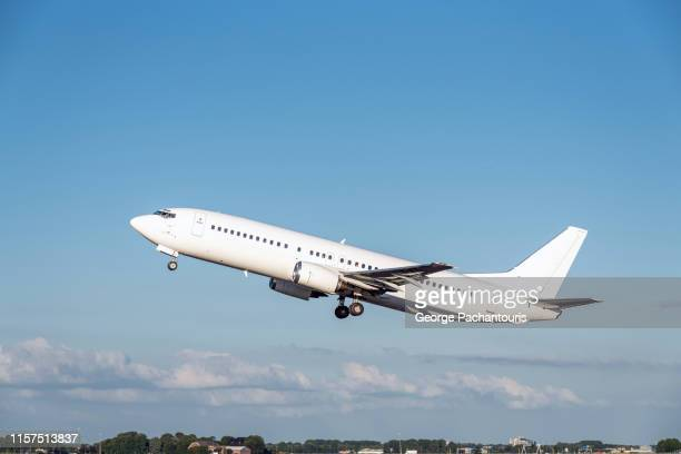 an airplane just after take off - aeroplane stock pictures, royalty-free photos & images