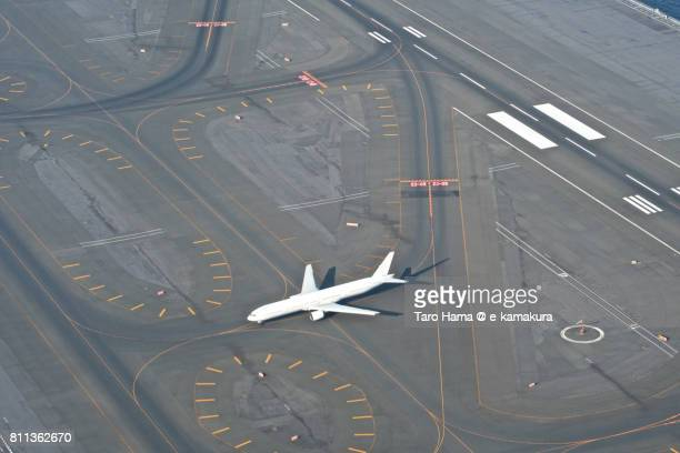 An airplane landed on Tokyo Haneda International Airport daytime aerial view from airplane