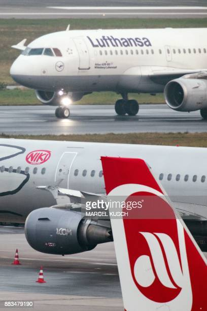 An airplane of German airline Lufthansa rolls past planes of the airlines Niki and Air Berlin at the airport in Duesseldorf western Germany on...