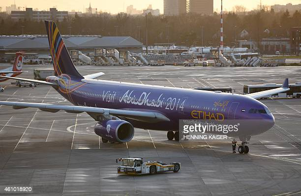 An airplane of the Etihad airline arrives at the airport in Duesseldorf western Germany after arriving 30 hours late from Abu Dhabi on January 4 2015...