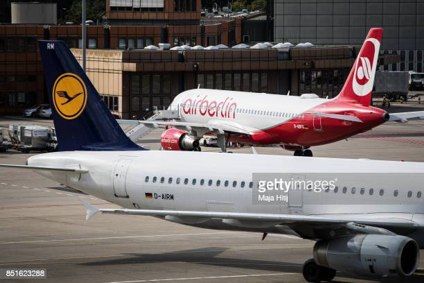 An airplane operated by German airline 'air berlin' and plane of Lufthansa are seen at Tegel airport in Berlin on September 22 2017 in Berlin Germany