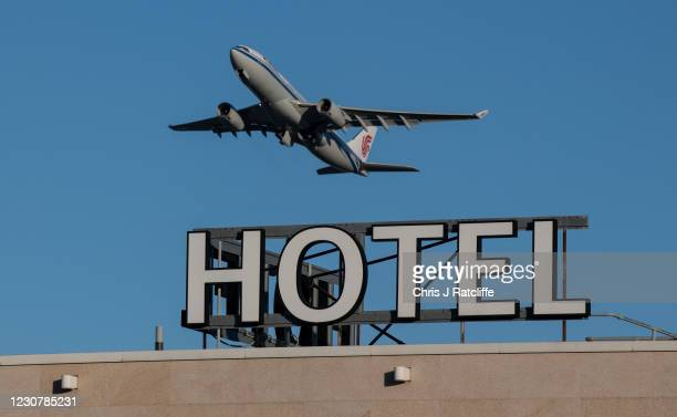 An airplane passes over a Sofitel hotel as it takes off from a runway at Heathrow Airport on January 25, 2021 in London, England. The mayor of London...