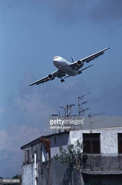 An airplane prepares to land at Kai Tak Hong Kong's old airport in Kowloon