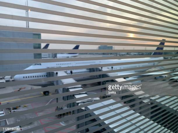 An airplane seen from inside an airport.