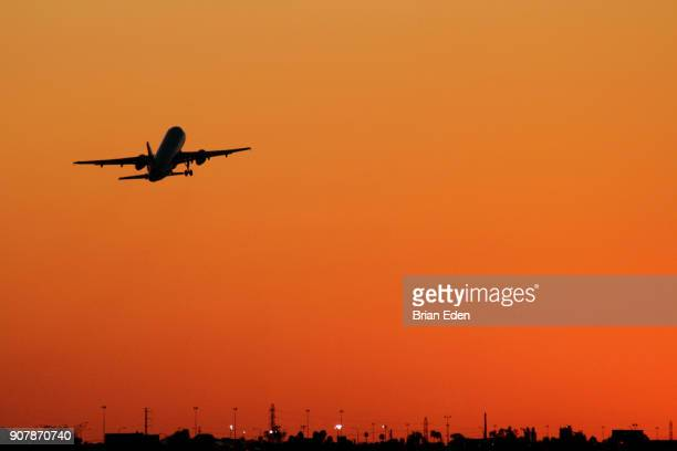 An airplane takes off at sunset from Phoenix Sky Harbor International Airport