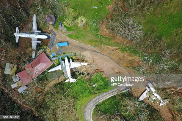 An airplane themed restaurant is seen damaged by mudslides and winds in Barranquitas southwest of San Juan Puerto Rico on September 24 2017 following...