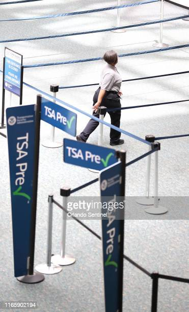 An airport employee wolks near the TSA Pre screening area as Orlando International Airport is closed on Tuesday September 3 2019 ahead of Hurricane...