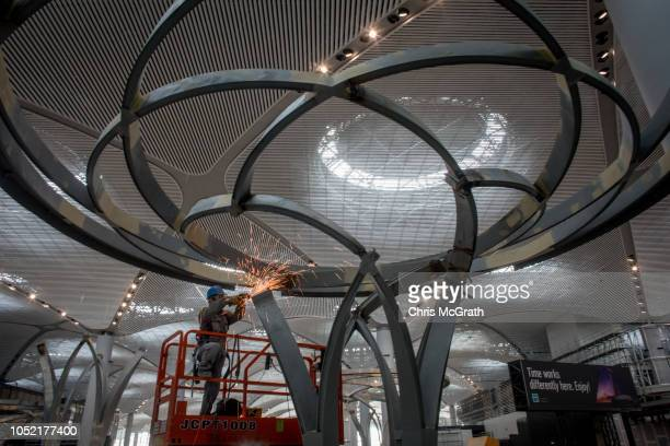 An airport employee works in the main hall of the Istanbul New Airport on October 6 2018 in Istanbul Turkey Construction continues around the clock...