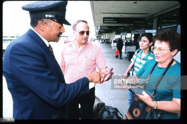 An airport guard checks identification at Los Angeles International Airport June 28 1995 in Los Angeles CA Security at the airport was stepped up...