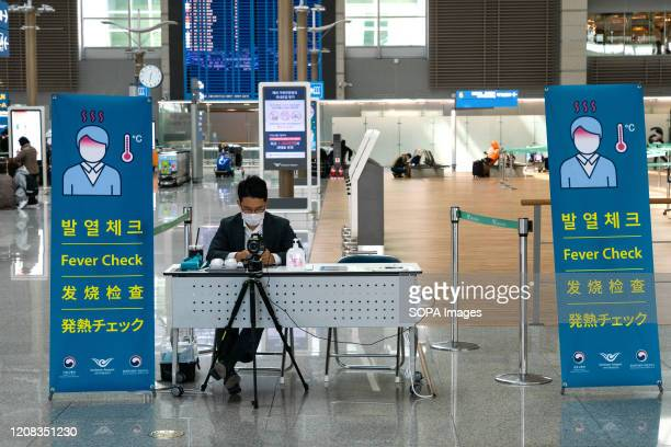 An airport staff member waits for passengers. Number of Incheon Airport passengers falls to record low amid coronavirus spread.