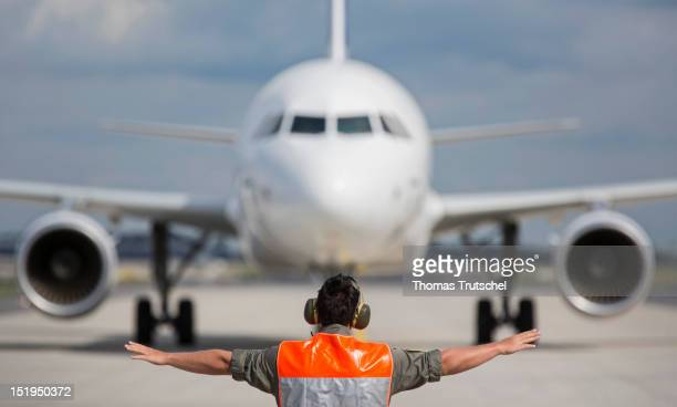 An airport worker is seen in front of an Airbus A320 at the Internationale Luft- und Raumfahrtausstellung Berlin Air Show on September 12, 2012 in...