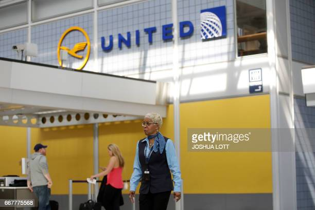 An airport worker walks through the United Airlines terminal at O'Hare International Airport on April 12 2017 in Chicago Illinois United Airlines has...