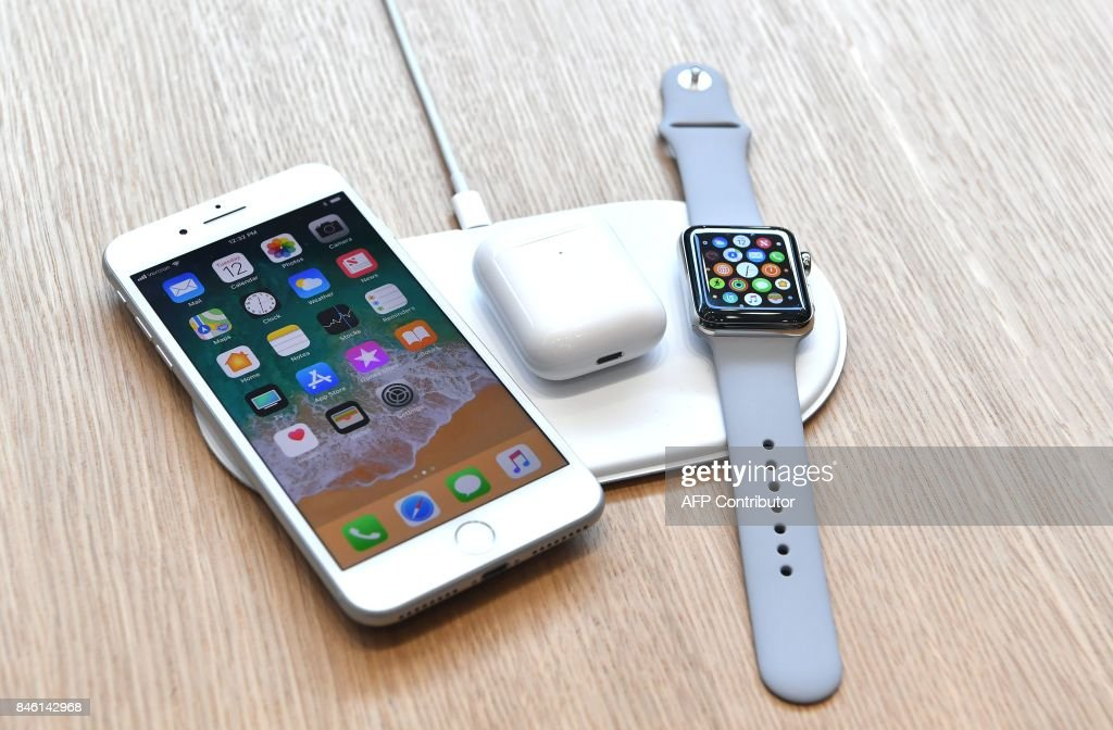 An AirPower mat is seen charging multiple devices during a media event at Apple's new headquarters in Cupertino, California on September 12, 2017. / AFP PHOTO / Josh Edelson