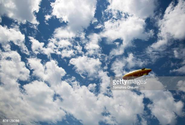 An airship with illustrations of Pikachu a character from Pokemon series game titles flies during the Pikachu Outbreak event hosted by The Pokemon Co...