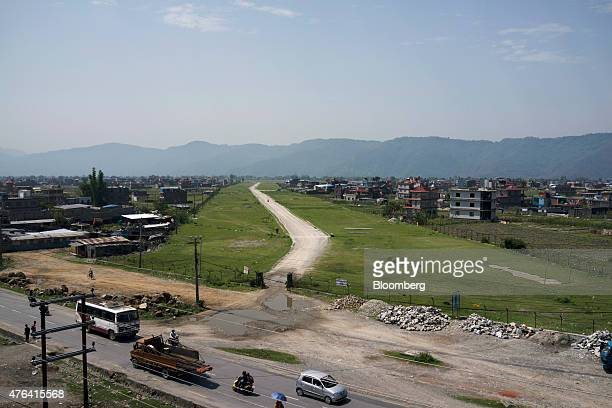 An airstrip sits under construction at the proposed site for a new airport in Pokhara Nepal on Tuesday June 2 2015 Nepal's gross domestic product...