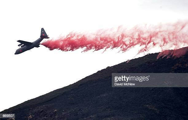 An airtanker drops fire retardant January 5 2001 during mopup operations of the Viejas fire near Alpine CA Firefighters relied heavily on aircraft to...