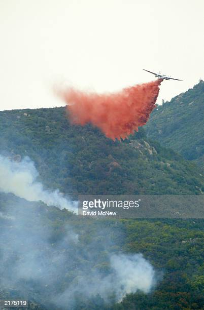 An airtanker drops fire retardant on the southwest flank as the Coyote Fire burns more than 13000 acres of chaparral and forest on July 18 six miles...