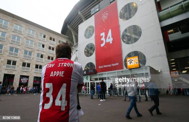 An Ajax fan wears a shirt saying stay strong Appie in support of Abdelhak Nouri of Ajax before the UEFA Champions League Qualifying Third Round match...