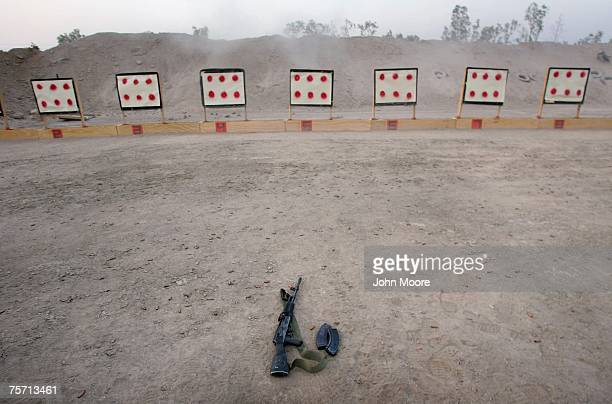 An AK47 sits idle at a firing range during a training session with US Navy SEALS and Iraqi army scouts July 26 2007 in Fallujah Iraq The SEALS are...