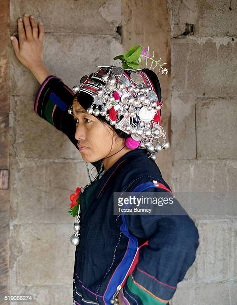 An Akha woman dressed in traditional clothing made from handspun indigo dyed cotton at a wedding in Ban Lang Pa village Luang Namtha province Lao PDR...