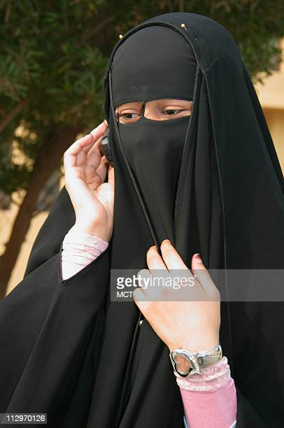 An Al Azhar University student dons a black niqab November 24 in Cairo Egypt Despite a government drive to isolate Egyptian women who cover their...