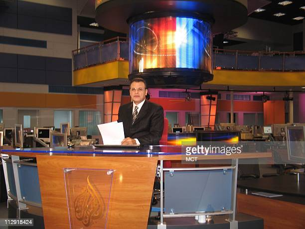 An Al Jazeera anchor prepares for a live newscast at the station's recently renovated studio in Doha Qatar This year marks Al Jazeera's 10th...