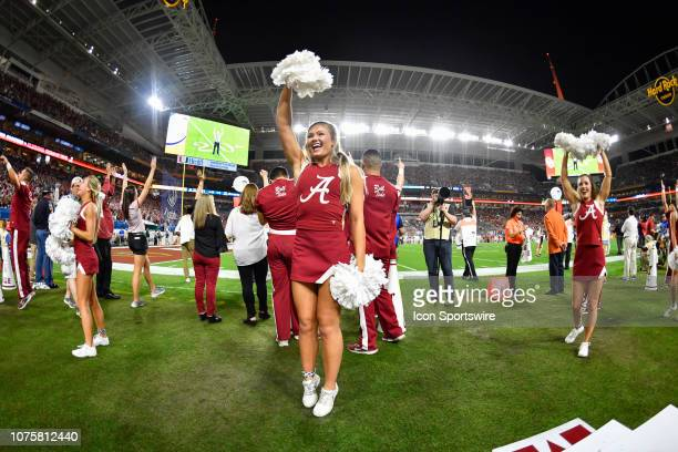 An Alabama cheerleader performs during the first half of the CFP Semifinal at the Orange Bowl between Alabama Crimson Tide and the Oklahoma Sooners...