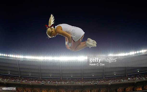 An Alabama Crimson Tide cheerleader is tossed in the air prior to the game against the Mississippi Rebels at BryantDenny Stadium on September 19 2015...