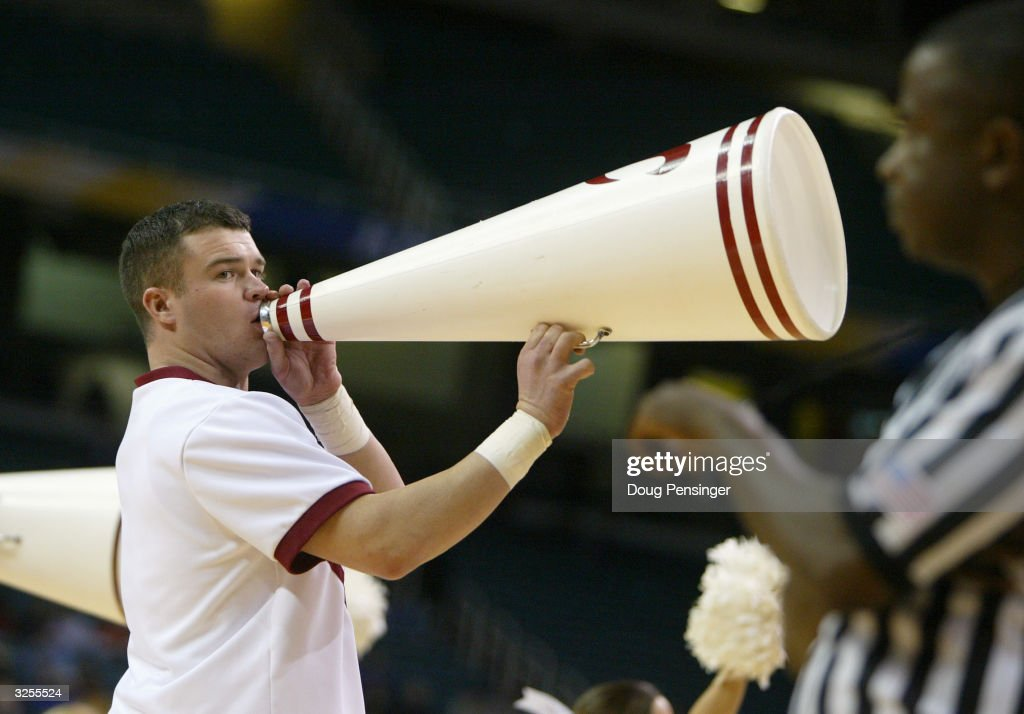 An Alabama Crimson Tide cheerleader yells throw a horn during the second round of the SEC Men's Basketabll Tournament against the Florida Gators on March 12, 2004 at the Georgia Dome in Atlanta, Georgia. Florida defeated Alabama 75-73 in overtime.