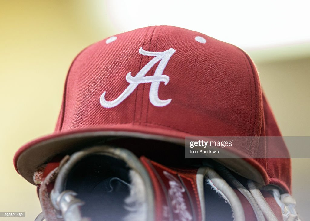 An Alabama Crimson Tide hat rests in the dugout during a game ... 0ba1a1a2902e