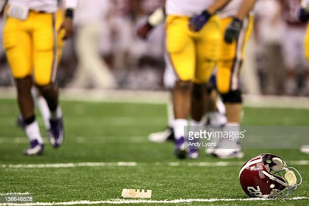 An Alabama Crimson Tide helmet lies on the field during the 2012 Allstate BCS National Championship Game at MercedesBenz Superdome on January 9 2012...