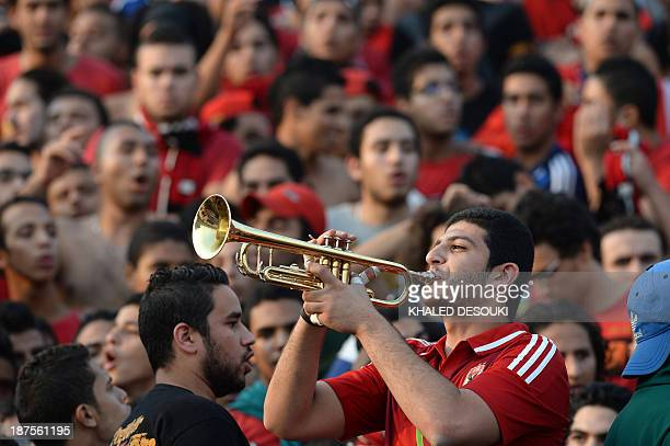 An AlAhly fan blows his trumpet prior to their African Champions League second leg final Egypt's AlAhly versus South Africa's Orlando Pirates in...