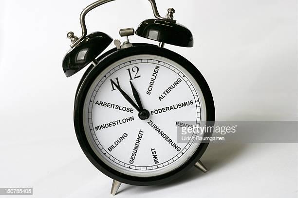 An alarm clock Symbolic image to lick the republic into shape