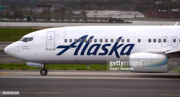 An Alaska Airlines Boeing 737 jet taxis to a gate after landing at Ronald Reagan Washington National Airport in Washington DC