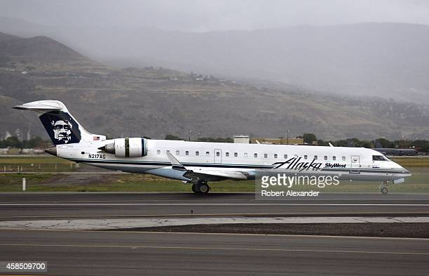 An Alaska Airlines Bombardier CRJ700 passenger aircraft takes off on a runway at Salt Lake City International Airport in Utah